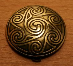 For folk style and celtic culture lover :)  Brass pendant with celtic spirals ornament etched, has a form of dome.  Diameter of each earring - 3cm or