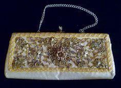Caron of Houston embellished gold clutch