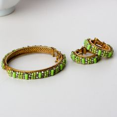 https://www.etsy.com/treasury/NTgxMTIxMXwyNzI0Nzk0NTEy/elite-rainbow-two  Miriam Haskell Bangle and Earring Set by TwiceBakedVintage on Etsy, $180.00