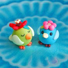 Polymer clay birdies by JooJoo.