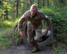 U.S. Army 2nd Lt. Davis Hayden, assigned to the 12th Combat Aviation Brigade, overcomes an obstacle during the 2016 European Best Warrior Competition held at the 7th Army Training Command's Grafenwoehr Training Area, Germany.