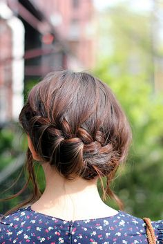 Loose French braid, to the side and tucked under.  (Excellent Satur-date hair, and discovered just in time!)