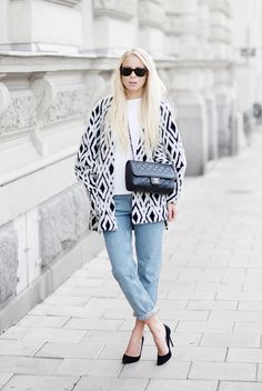 Swedish blogger Victoria Törnegren adds punch to the classic white tee & blue jeans combo with a black & white coat from H&M. | H&M OOTD