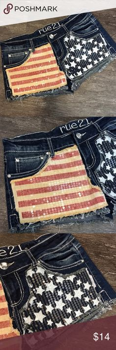 """{rue 21} Patriotic Shorts Distressed sequined stars and stripes denim shorts by Rue 21. Size 5/6.   Closure: Front Zipper and Button Material: 98% Cotton 2% Spandex   Measurements  Waist: 31"""" lying flat, stretches to 34""""  Length: 9.5""""  Inseam: 2""""  Front Rise: 7.5""""  Back Rise: 12.5""""   #patriotic #flag #stars #stripes #fourthofjuly #4thofjuly #independenceday #redwhiteandblue Rue 21 Shorts Jean Shorts"""