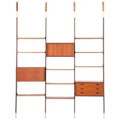 Italian Teak and Brass Floor to Ceiling Wall Unit -Bookshelf, 1950s  | From a unique collection of antique and modern shelves at https://www.1stdibs.com/furniture/storage-case-pieces/shelves/