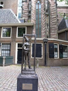 "Statue to honor the sex workers of the world. Installed March 2007 in Amsterdam, Oudekerksplein, in front of the Oude Kerk, in Amsterdam's red-light district De Wallen. Title is Belle, inscription says ""Respect sex workers all over the world. Tour En Amsterdam, Amsterdam Travel, Victoria Hotel Amsterdam, Amsterdam Red Light District, Cozy Cafe, Cities In Europe, Medieval Town, Old Buildings, Netherlands"