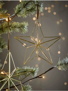 Made from golden wire in a contemporary but festive geometric star shape, our hanging tree decoration will add a metallic accent to your tree. Each decoration is hung on a faux suede loop for a luxurious feel. Minimal Christmas, Natural Christmas, Christmas Mood, Noel Christmas, Simple Christmas, Xmas, Christmas Ornaments, Christmas Wreaths, Christmas Tree Decorations