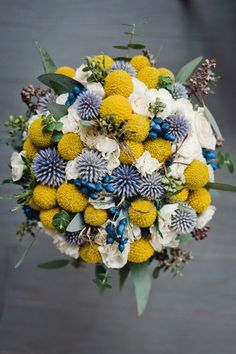 The perfect navy & yellow wedding bouquet with thistle & billy balls | Classic New London Connecticut Wedding With Spring Rains In Navy & Yellow | Photograph by Robyn Blasi Photography  http://storyboardwedding.com/classic-new-london-connecticut-wedding/