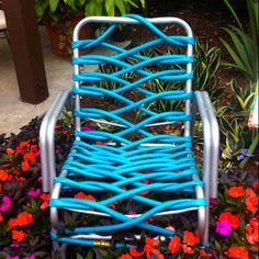 Old metal frame from chair. Colorful garden hose. Saw this at Epcot's Flower Festival this spring.