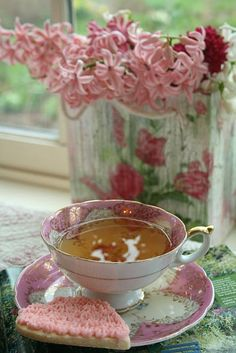 Sometimes when you have tea for breakfast you have to have pretty pink teacups & a pink sweet..........