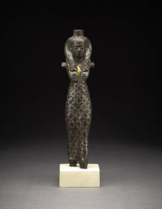 Copper alloy figure of a queen or divine consort, inlaid with gold detail, Third Intermediate Period (1069-664 BC)