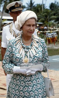 Queen Elizabeth ll and Prince Philip, Duke of Edinburgh, wearing bone necklaces, arrive in Tuvalu during a tour of the South Pacific on October 1982 in Tuvalu, Pacific Islands. Hm The Queen, Queen Love, Royal Queen, Her Majesty The Queen, Elizabeth Philip, Queen Elizabeth Ii, Princess Anne, Princess Margaret, Queen Hat