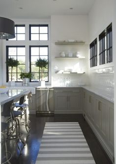 kitchens with no upper cabinets   Many of the photos above have a fabulous window wall instead of uppers ...