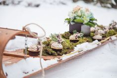 Vintage Sled Filled With Cupcakes | Winter Wedding | A Midday's Snowy Dream In A Winter Wonderland Of Glistening Snow, Moss & Antlers | Photograph by Wren Photography  http://storyboardwedding.com/a-middays-snowy-dream-in-a-winter-wonderland-of-glistening-snow-moss-antlers/