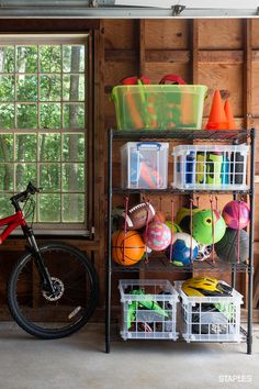 Minimize the mess with shelves and bins that are always standing at the ready to tame loose toys. Informations About Shop storage bins by Options, Prices … Garage Organization Tips, Diy Garage Storage, Shop Storage, Storage Bins, Outdoor Toy Storage, Ball Storage, Garage Storage Solutions, Garage Shed, Garage House