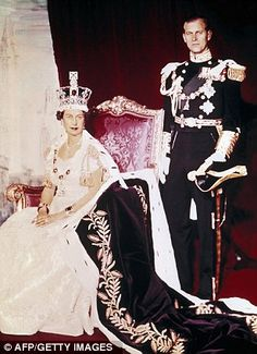 Britain's Queen Elizabeth II (L) and Prince Philip pose on the Queen's Coronation day, 02 June 1953, in Buckingham Palace, in London.