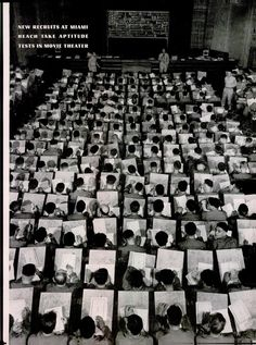 New U.S. Army recruits at Miami Beach take an aptitude test in a movie theater. December 1942, LIFE magazine.