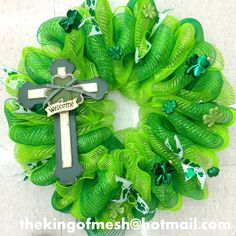 Create your own St Patrick's Mesh Wreath or order yours at: thekingofmesh@hotmail. com - Introducing my newest #meshwreath from latest #StPatricks collection. I got all my supplies at @MichaelsStores #craftssupplies #decomesh #custom #mesh #michaelsstores @thekingofmesh #homedecor #polydecomesh #green #shamrock #cross