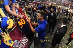 Stephen Curry of the Golden State Warriors signs autographs before the game against the LA Clippers on October 30 2017 at STAPLES Center in Los...