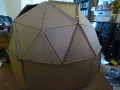 Cardboard geodesic play den - did this with the boys. I cut the triangles from bicycle boxes I got from a local shop. At first, I used fasteners. But, I found the process faster and just as sturdy using duct tape.