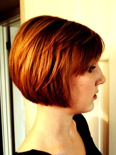Short bob. She is growing out a pixie cut. The cut is mostly solid form with previous layers still there.