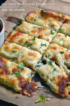 Low Carb Cauliflower Breadsticks with fresh herbs, garlic, and lots of ooey gooey cheese atop a cauliflower crust looks and tastes like cheesy bread! One of my favorite low carb recipes! Ketogenic Recipes, Low Carb Recipes, Diet Recipes, Cooking Recipes, Healthy Recipes, Dessert Recipes, Ketogenic Diet, Diet Desserts, Cheesecake Recipes