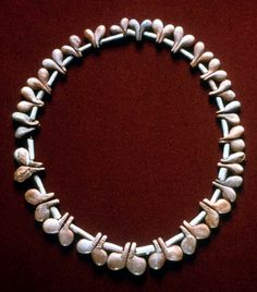 Natufian bone/tooth necklace, El Wad Terrace, Mt. Carmel, Israel, 12.5 - 10.8 BCE. Natufian burial practices show sophistication of ritual and symbolic activity, including personal adornments and inclusion of animal products/skeletons, in previously unknown intensity. Perhaps most elaborate society of Epipalaeolithic period.