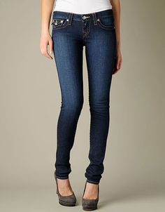 True Religions signature lowrise skinny leg Julie with back pocket flaps. Multi thread combination. Available in our Lonestar wash.