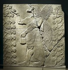 Brooklyn Museum: Egyptian, Classical, Ancient Near Eastern Art: Relief of Eagle-Headed Winged Figure Standing Between Two Sacred Trees