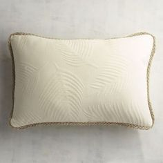 "<i>Matelasse</i> is French for ""quilted"" or ""cushioned"" and refers to fabrics that are supposed to mimic the style of Marseilles quilts. Our pillow has a cotton cover with a distinctive fern pattern and braided jute trim."