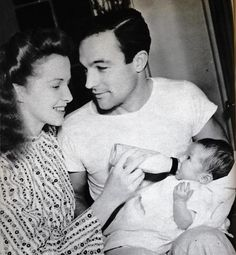 Gene Kelly as a Daddy... love the way he's looking at her. #genekelly #love