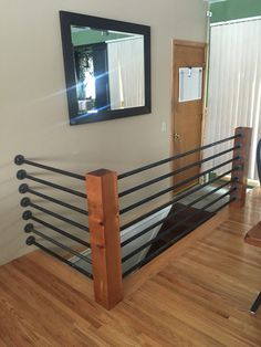 DIY banister. Floor flanges and black pipe. Support poles were made with 6x6 red cedar