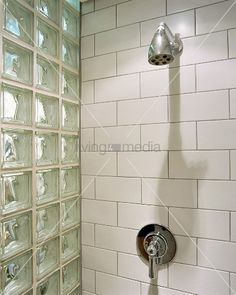 tiled shower with glass brick wall grey grout Loft Bathroom, Downstairs Bathroom, Bathroom Renos, Basement Remodeling, Bathroom Remodeling, Glass Brick, Attic Conversion, Wet Rooms, Shower Doors