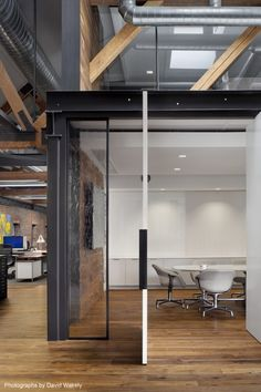 Epic office space Tolleson 6131 03 conf door 700x1050 Inside Tollesons Rustic San Francisco Warehouse Offices