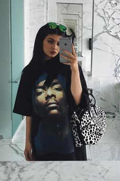 Kylie Jenner wearing Givenchy Nightingale Dalmatian-Print Satchel Bag and Vetements Snoop Dogg T-Shirt