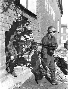 "kruegerwaffen: "" Two german soldiers redeploying a Heavy MG-34. """