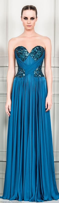 A stunning blue gown with a few sequins that are eye caching but still has a subtle pop that its not like whoa that looks strange but it still has that wow factor