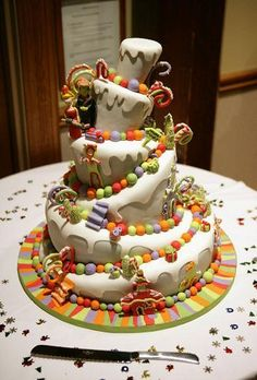 Grinch - one of my all time favourites.   The most amazing couple took me out for dinner to plan their off the wall wedding cake.  When I delivered it I thought we had gone to the wrong hall... it was such an elegant wedding.   I was thrilled to have this as one of my very first wedding cakes.   Seems like forever ago now. www.toonicetoslice.ca