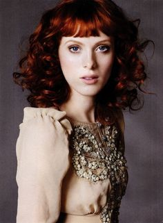 red curls with short bangs. Seriously this is my idea of perfect hair. Why does it have to be on her? She would look good with pubes on her head.