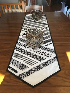 Black and white table runner. It displays very nicely. I handsewed the binding on the back of it. It is made of all cottons. It measures 60 long by 15 wide. Would look nice on a long or shorter table Quilted Table Runners Christmas, Patchwork Table Runner, Christmas Runner, Table Runner And Placemats, Table Runner Pattern, Christmas Quilting, Quilt Table Runners, Modern Table Runners, Black And White Quilts