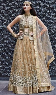 Buy georgette and net golden partywear lehenga style anarkali salwar kameeswith heavy thread work and embellishments with pure chiffon dupatta at Kalpanas Creations. The Anarkali Salwar Kameez is comes with both trouser and lehanga (skirt). Designer Salwar Kameez, Designer Anarkali, Gold Lehenga, Green Lehenga, Net Lehenga, Lehenga Choli, Heavy Lehenga, Sarees, Eid Dresses