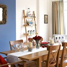 Dining room with coastal touches for a summer feel. Candle lanterns filled with tiny shells. Ladder shelf with nautical displays. Browse room by room at Completely Coastal: http://www.completely-coastal.com/p/coastal-beach-and-nautical.html  #diningrooms #coastal #nautical