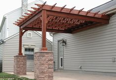 pergola - attached to the house with stone at columns