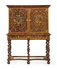 A CHARLES II WALNUT, OLIVE OYSTER-VENEERED AND FLORAL MARQUETRY CABINET-ON-STAND  CIRCA 1680