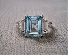 """Upgraded Aquamarine and Diamond Engagement Ring Emerald Cut Baguette Classic Blue White Gold timeless PenelliBelle Exclusive """"The Margo"""" by PenelliBelle on Etsy Emerald Cut Diamond Engagement Ring, Halo Diamond Engagement Ring, Emerald Cut Aquamarine Ring, Aquamarine Jewelry, Ring Set, Ring Verlobung, Pretty Rings, Beautiful Rings, Aquamarin Ring"""
