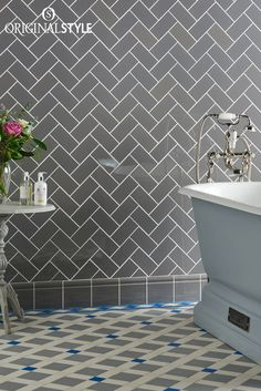 Wall tiles by Original Style, Artworks Range, London Stone Half Field Tiles. A versatile grey tile which can look both classic and contemporary in bathrooms and kitchens. In this instance the grey tiles have been arranged in a herringbone format for a contemporary feel. Looks even better with a Norwich Victorian Floor Tile pattern.