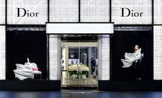 White free-form drapes accentuate Dior's femininity