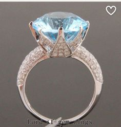 Reserved for Alex, 12ct Swiss Blue Topaz Lotus Flower Ring