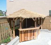 Nice tiki bar in the corner of a pool deck