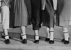 Teenage girls wearing the fashion trend of 1953; dog collars fastened around their ankles, on the right if you had a boyfriend and on the left if you were single.
